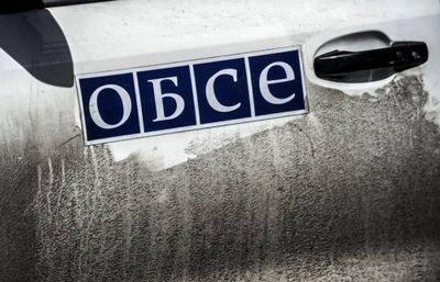 Лнр: украинские силовики обстреливают место подрыва машины обсе - «военные действия»